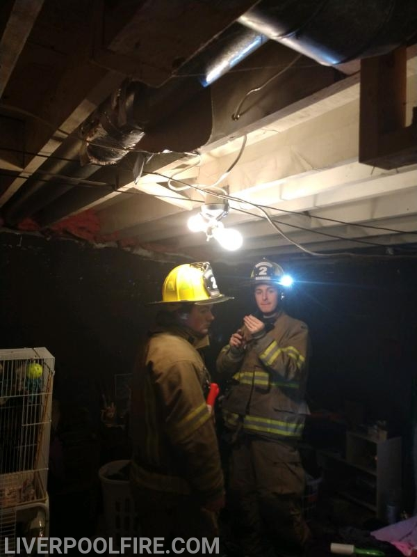 Firefighters/bunk-ins Dalton Majors and Troy Dykman preparing to install a smke detector